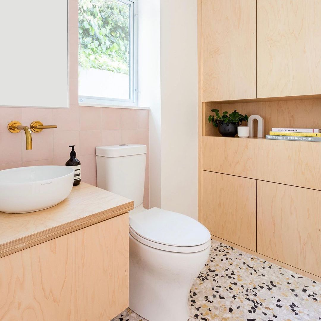 Pink bathroom with terrazzo flooring