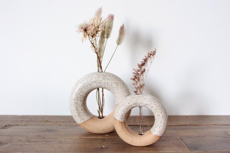 Donut vases with speckles.