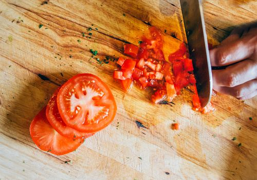 Diced tomatoes on wooden cutting board