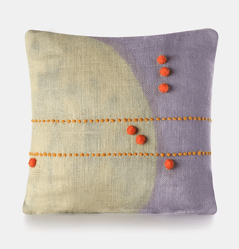 A printed lavender pillow, currently for sale at Anthropologie