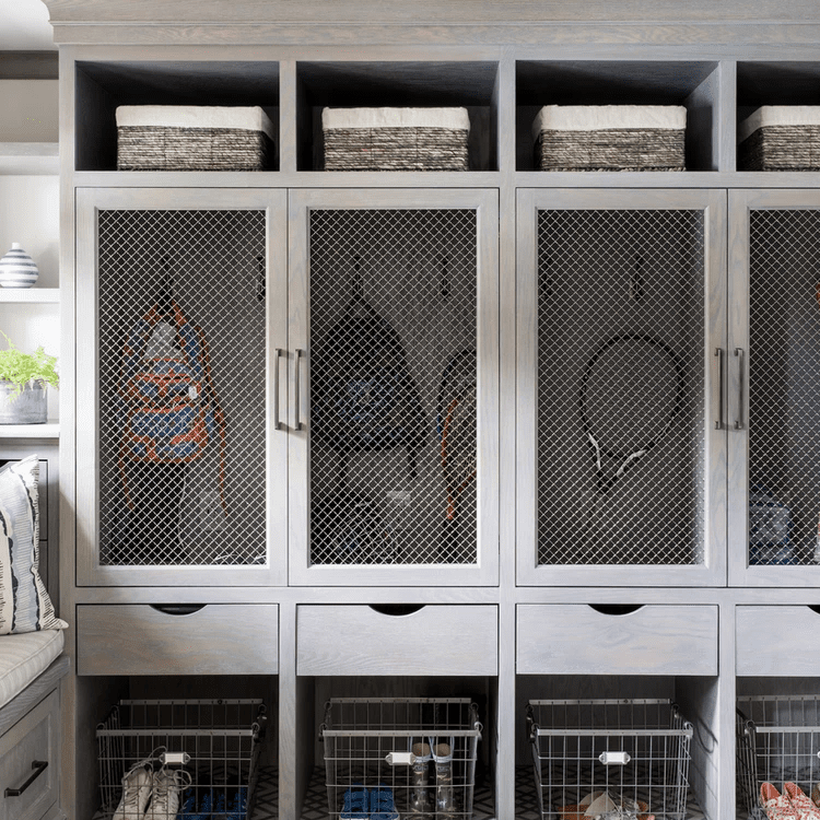 A gray mudroom filled with lockers, drawers, and baskets