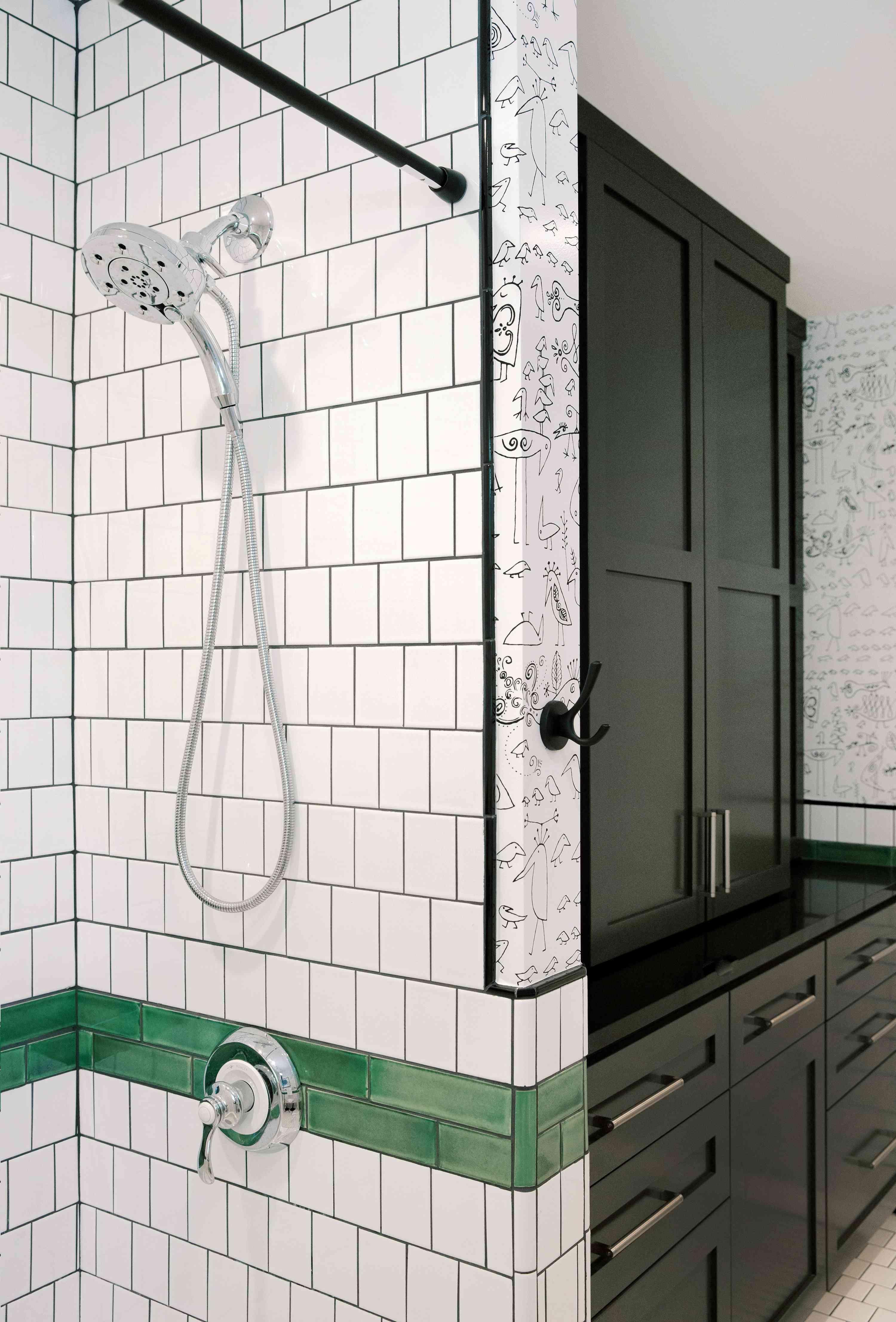Black storage cabinet next to shower.