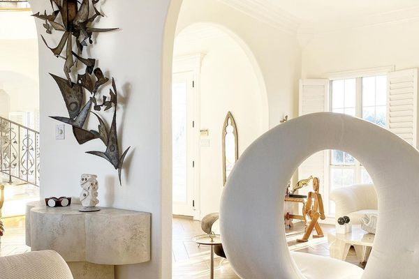 White living room with funky furniture.