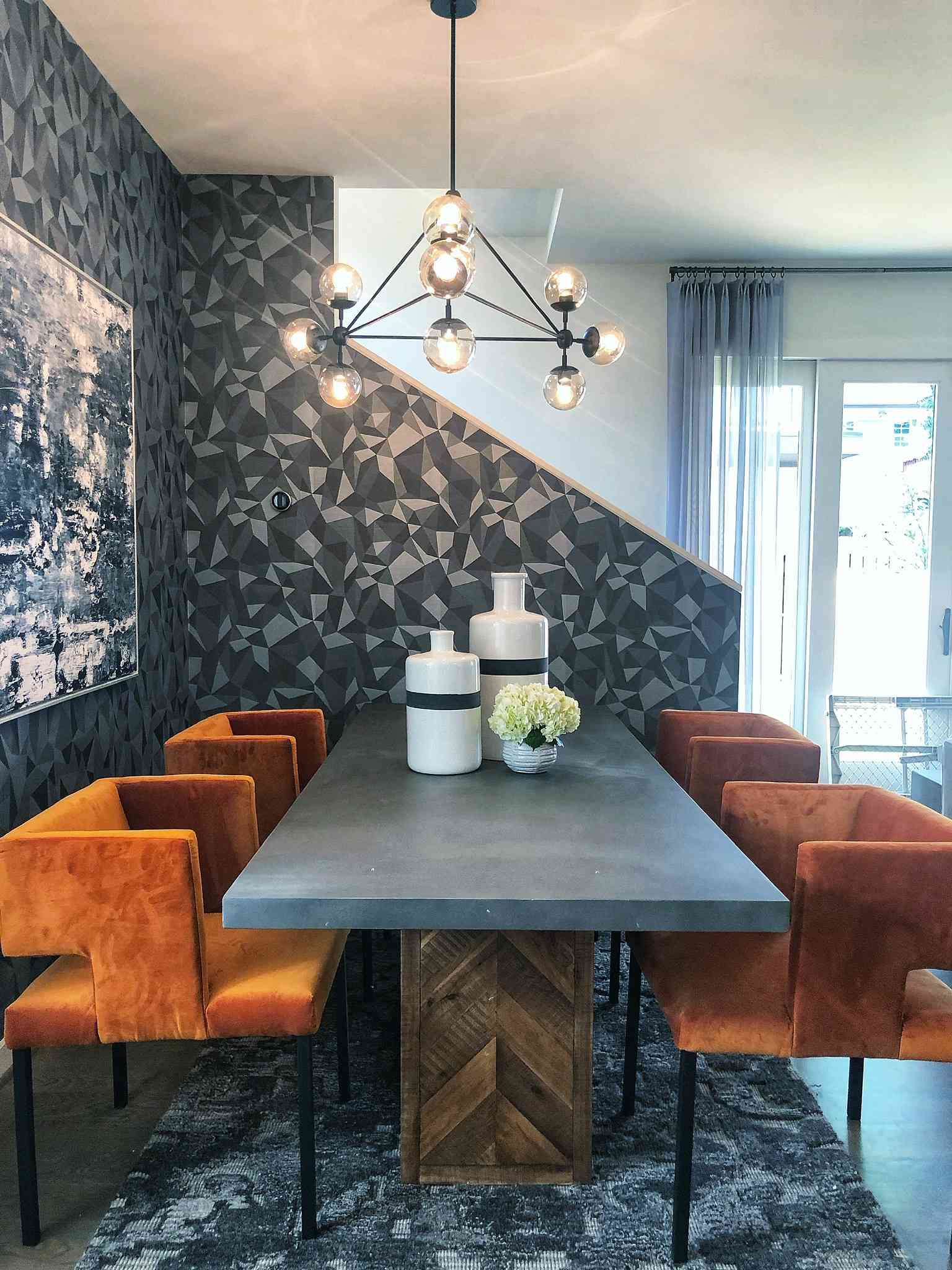 Wallpaper in modern, luxe dining room.