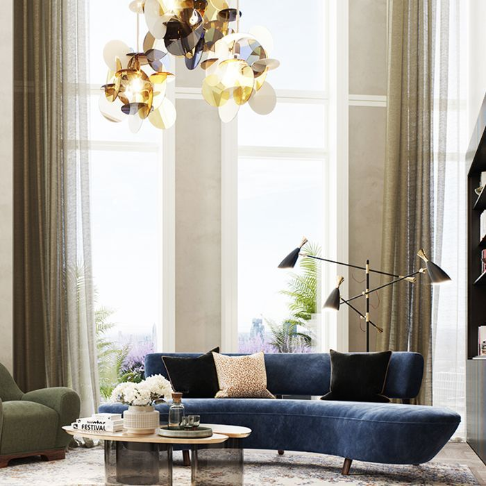 a living room with a blue sofa
