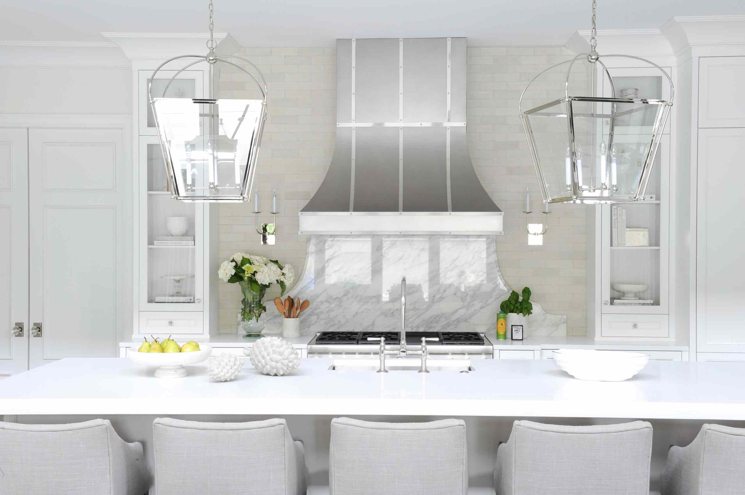 Glam kitchen with marble behind the stove