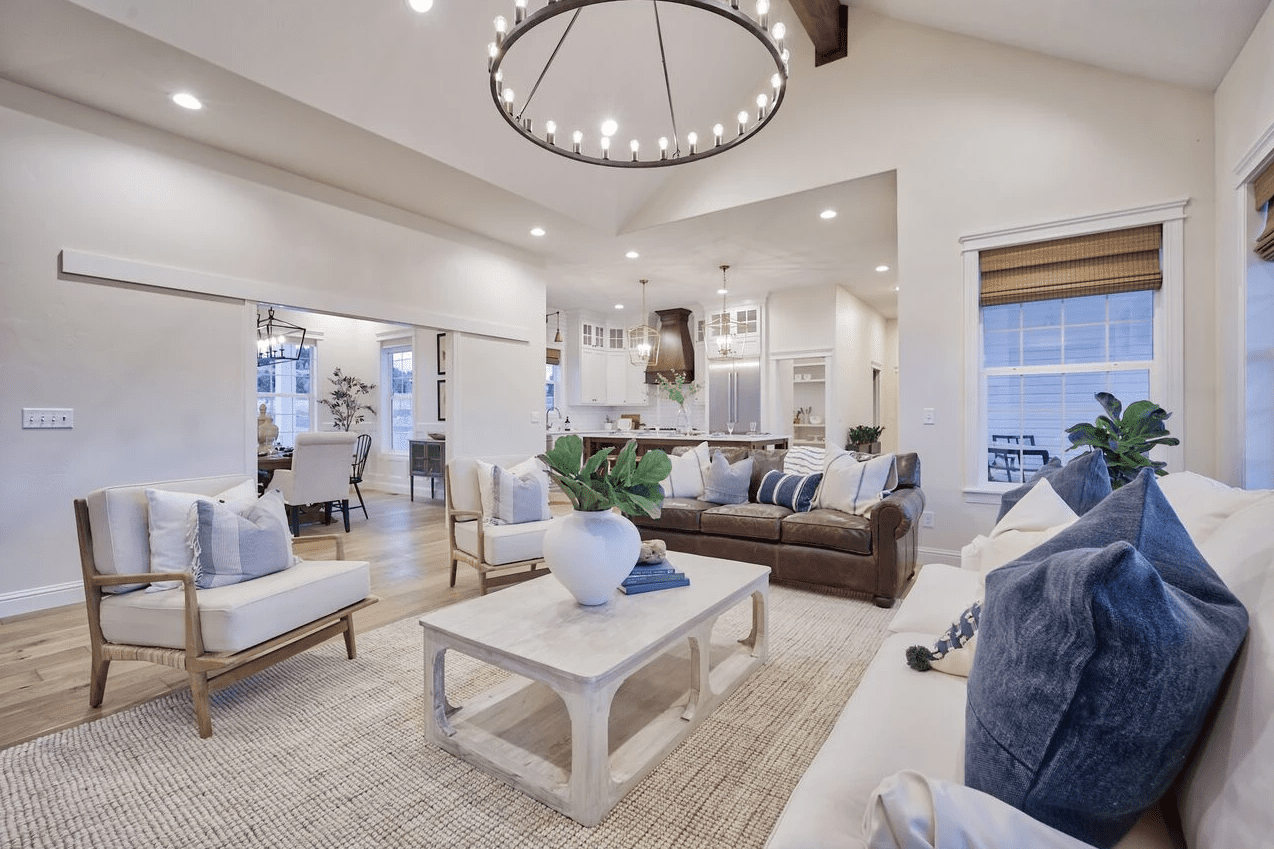 Large area rug in neutral living room.