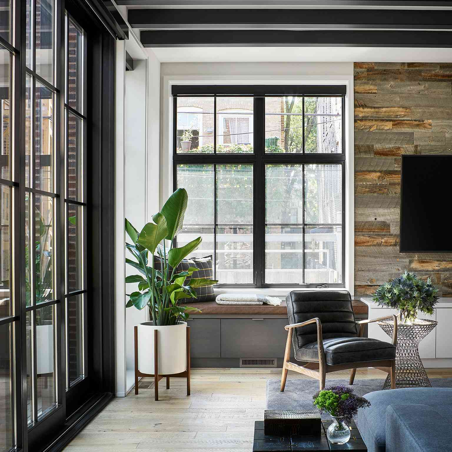 Living room with rustic reclaimed wood accent wall