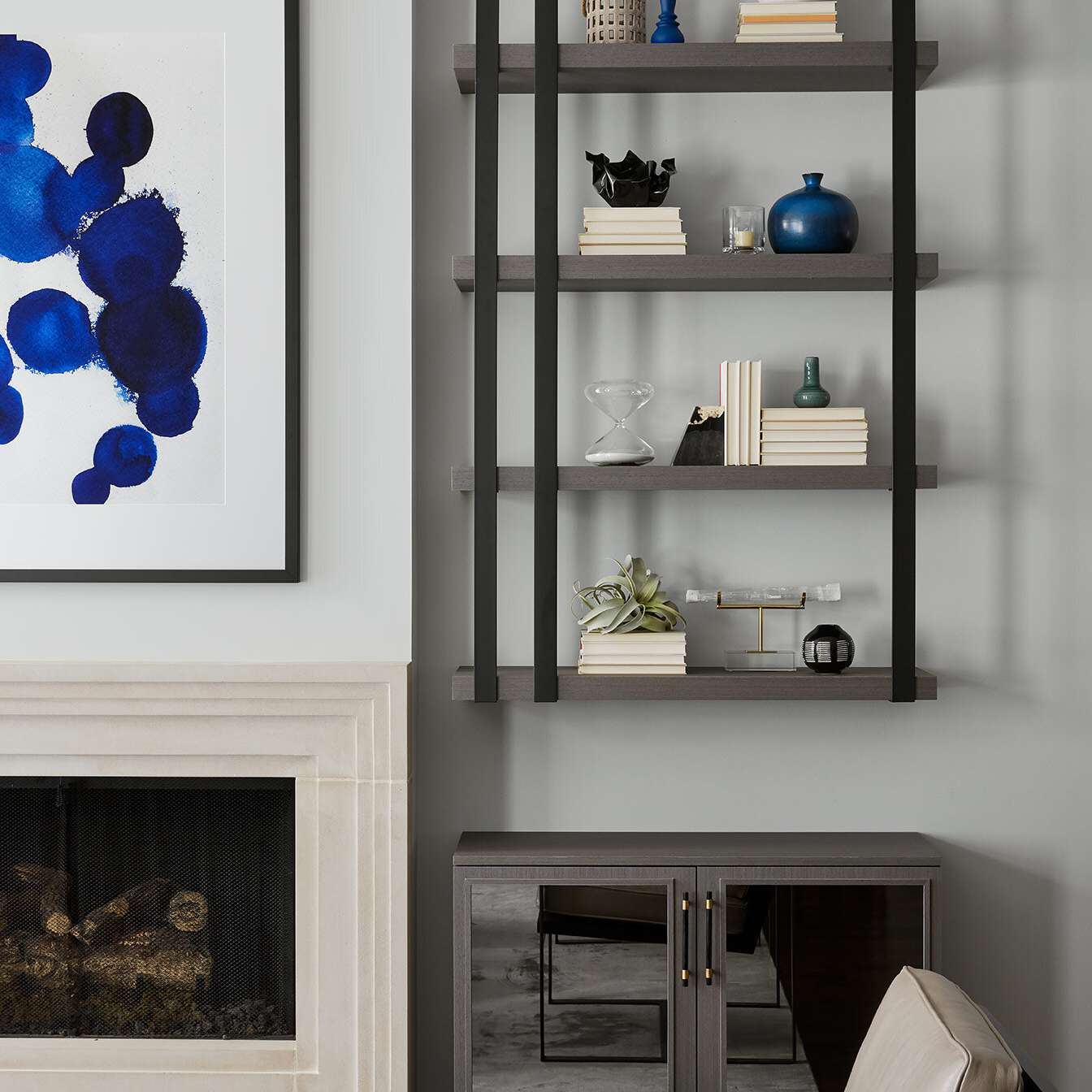 A living room decorated with sleek furniture and industrial pipe shelves