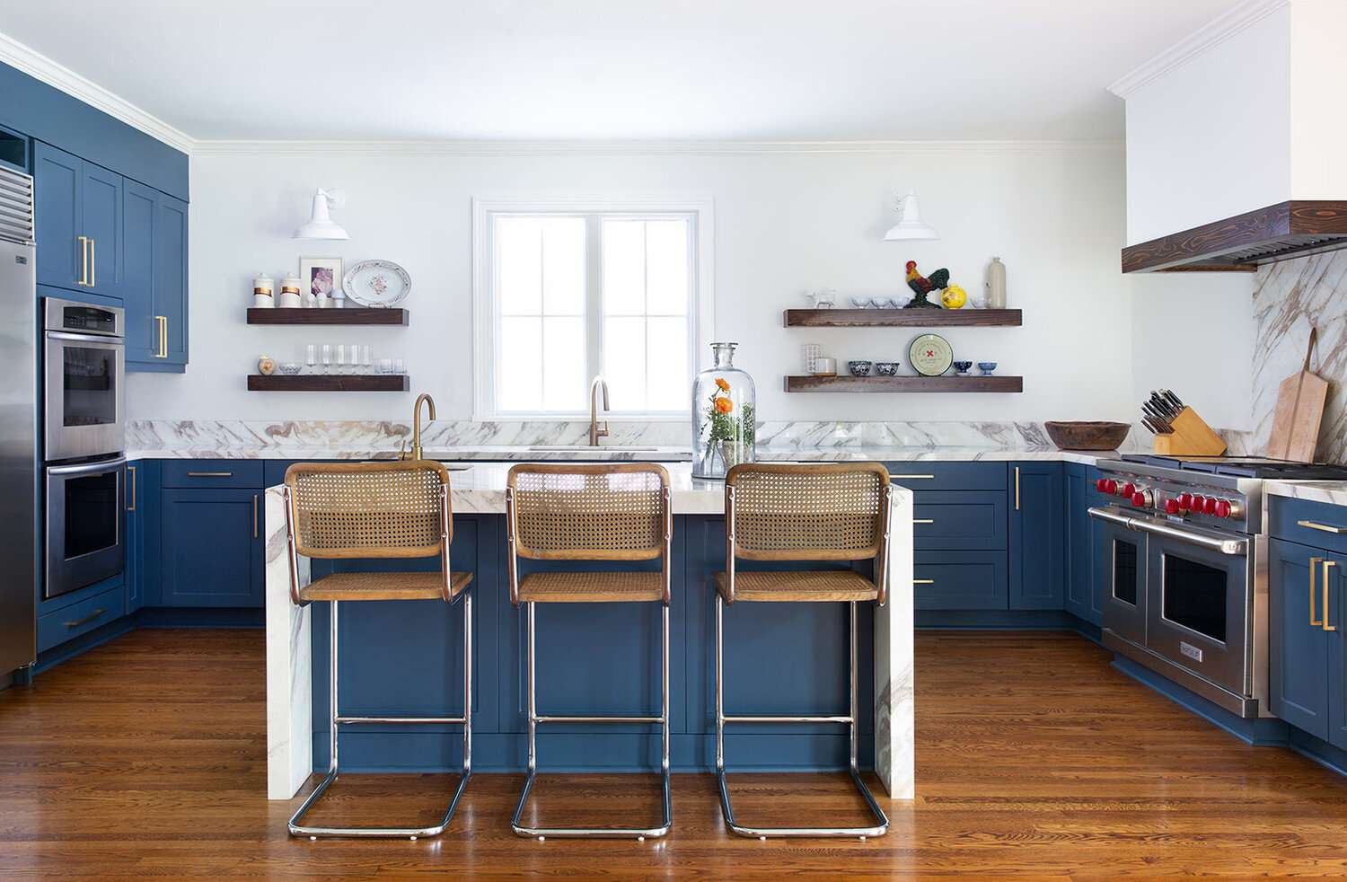 Playful blue and white kitchen with marble countertops.