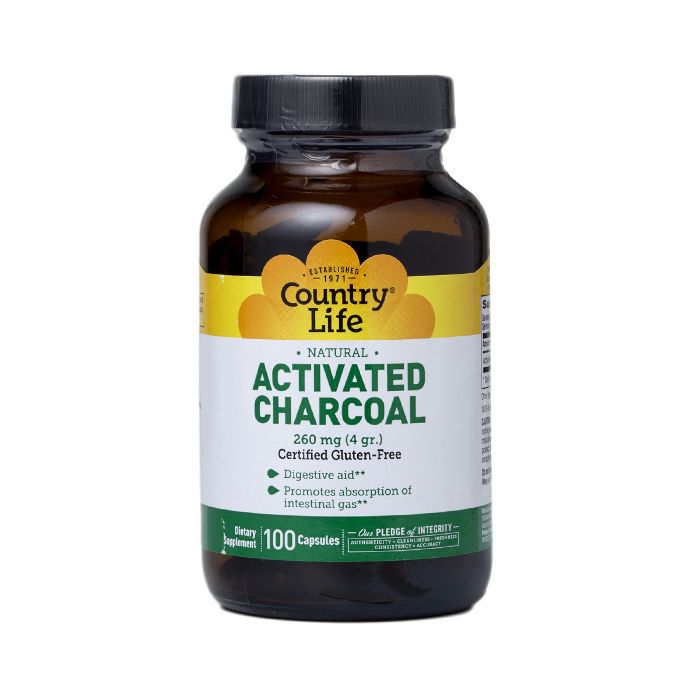 Activated charcoal tablets in a brown jar with black lid and yellow, white, and green label.
