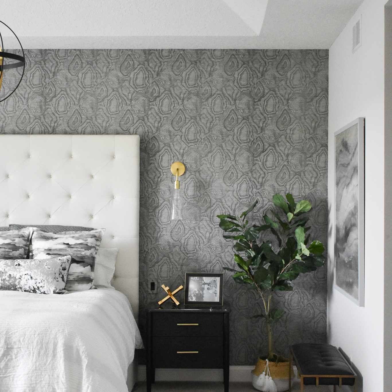After shot of bedroom with new wallpaper and chic furniture.