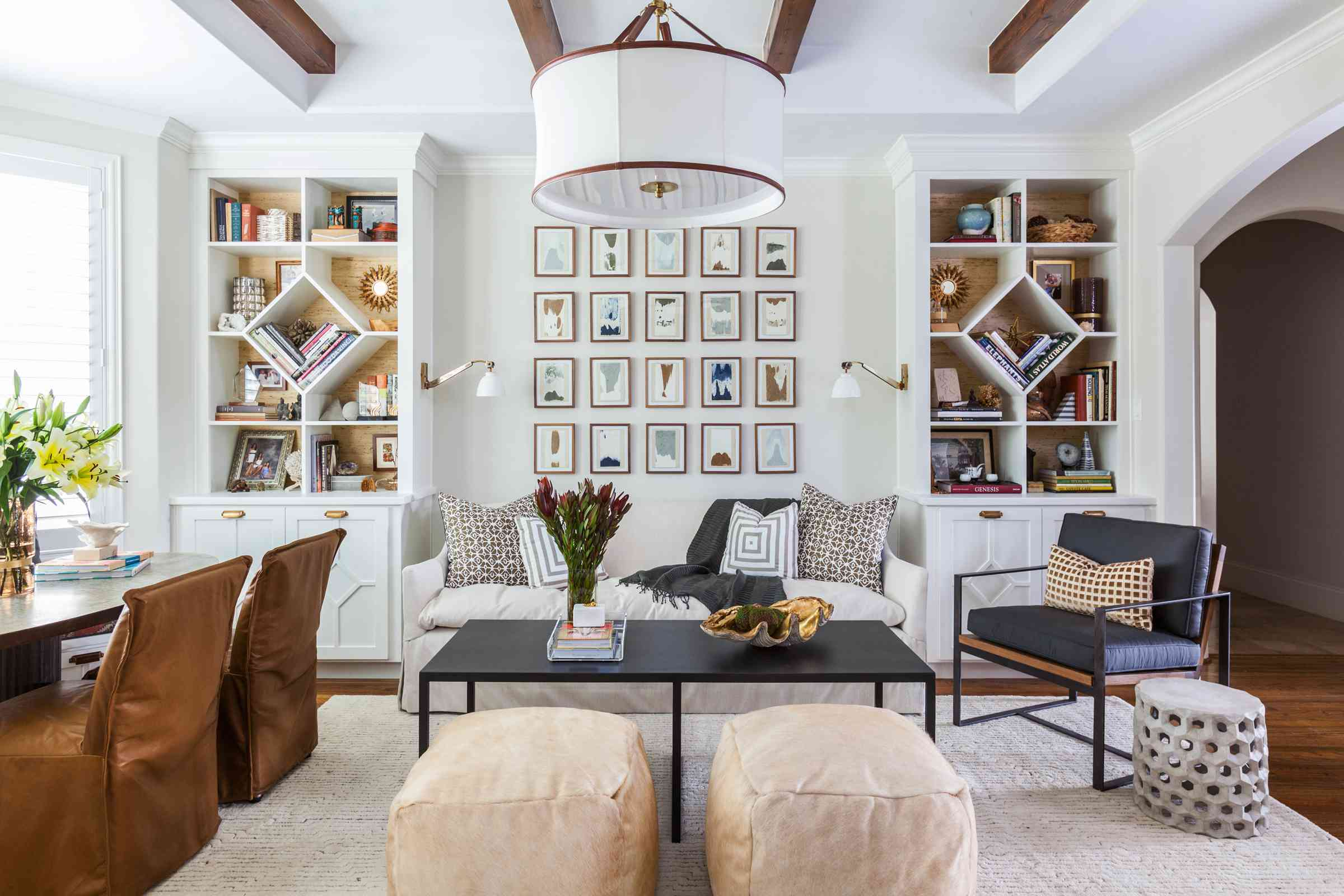 living room with matching bookcases, both with diamond shaped shelves in center