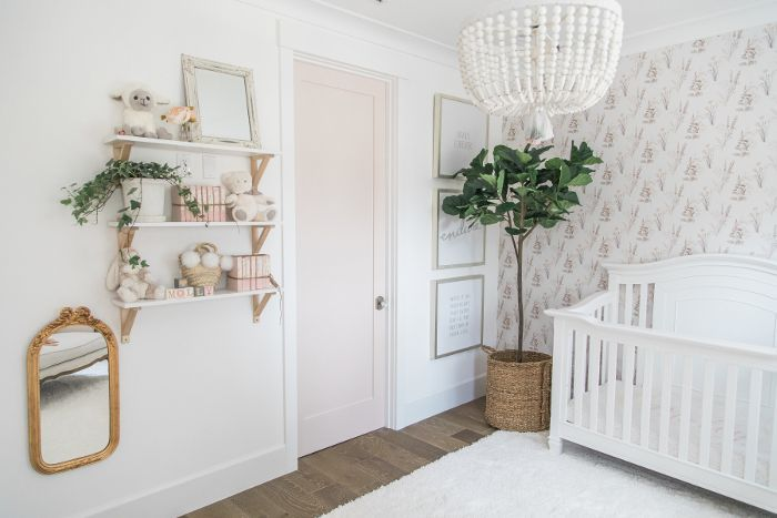 A fiddle leaf fig tree in daughter Molly's pink and white bedroom