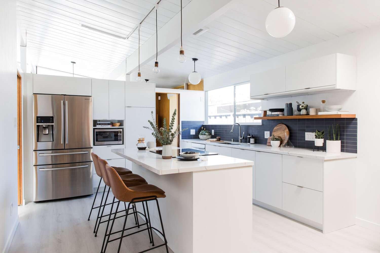All white kitchen with blue subway tile backsplash