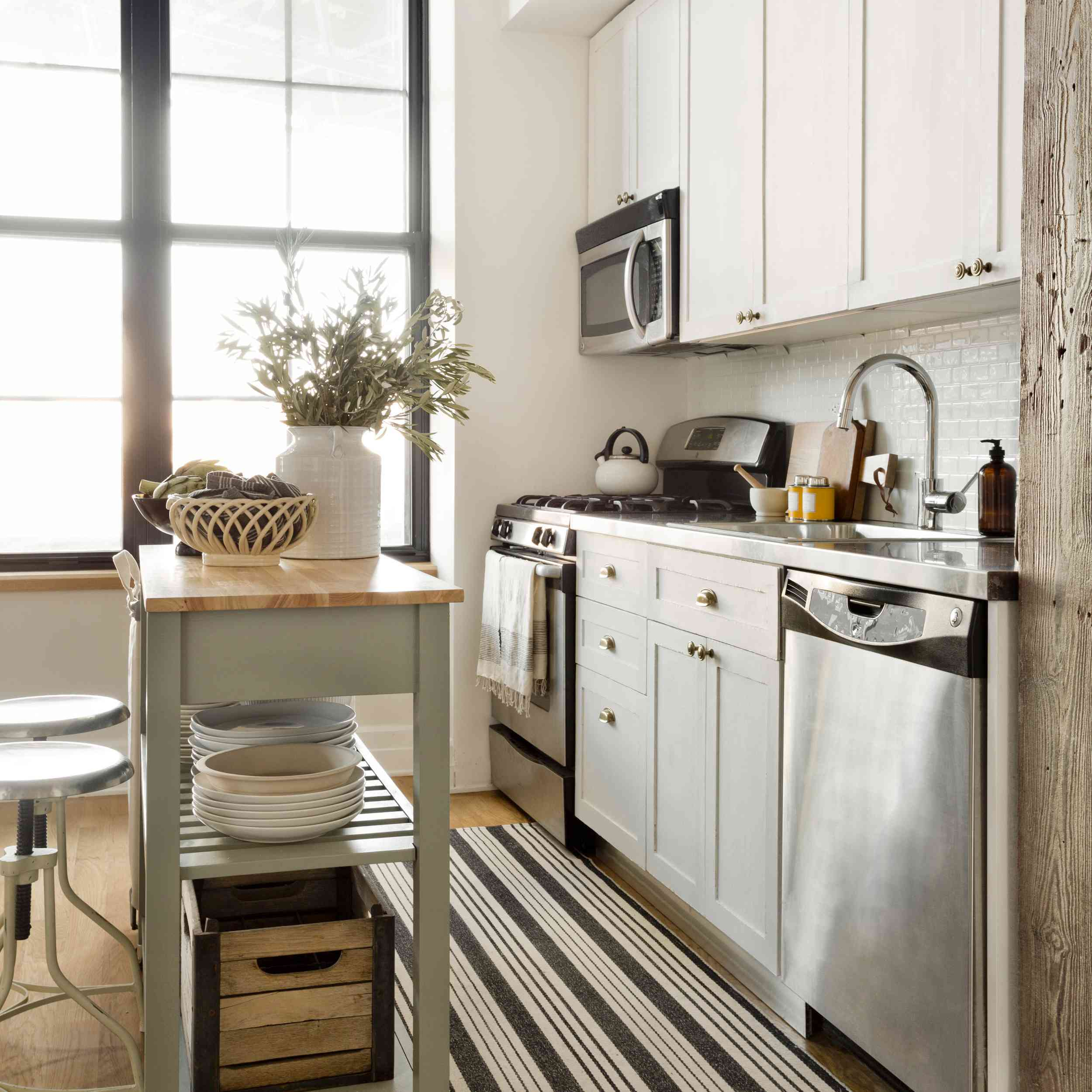 Apartment kitchen with rolling island cart