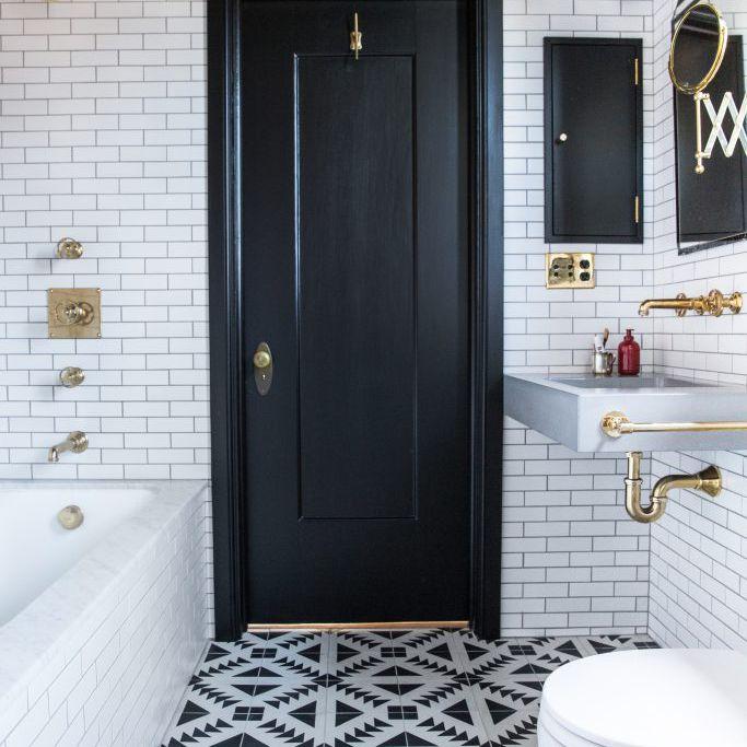 Bathroom with a black door