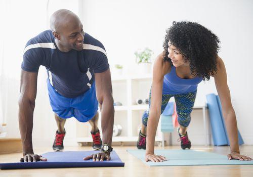 man and woman doing yoga together