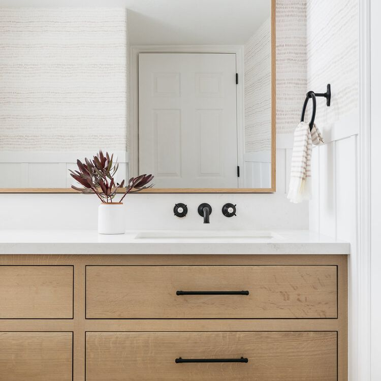 Neutral and blush bathroom with wood accents