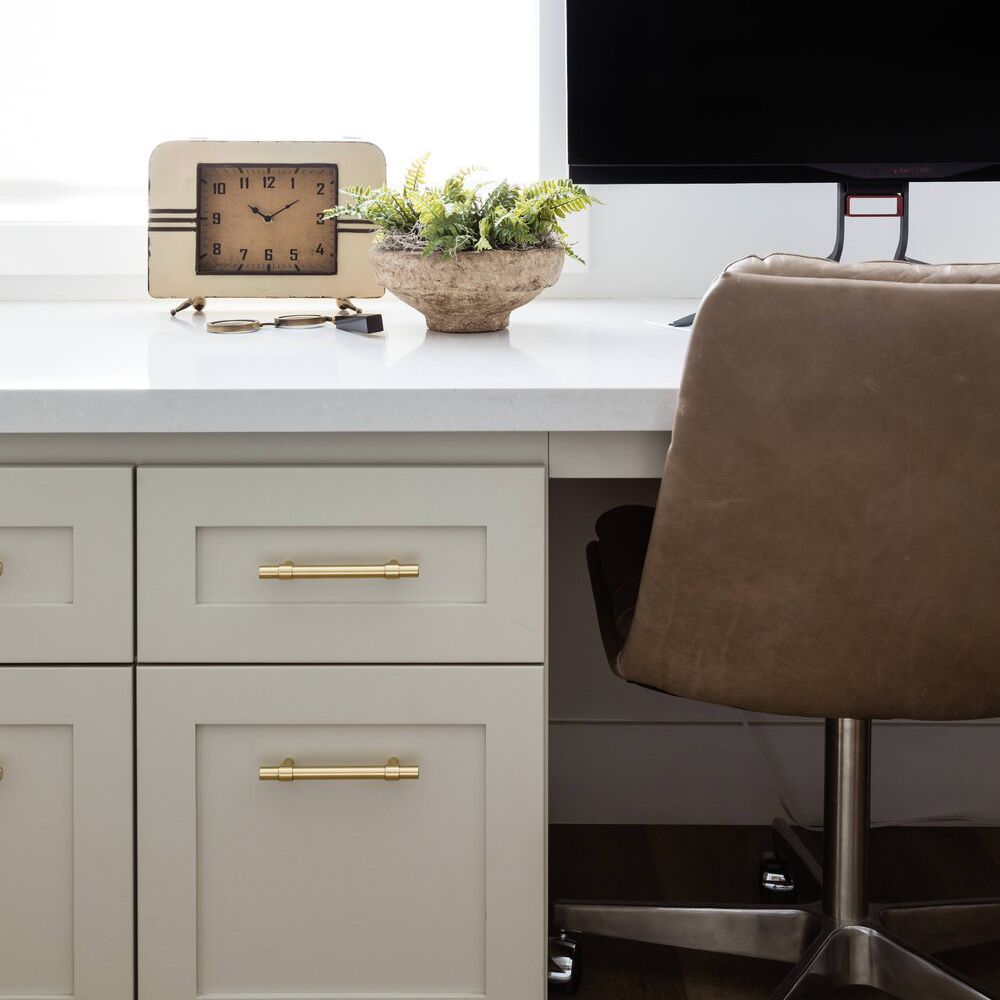 Neutral desk with small plant.