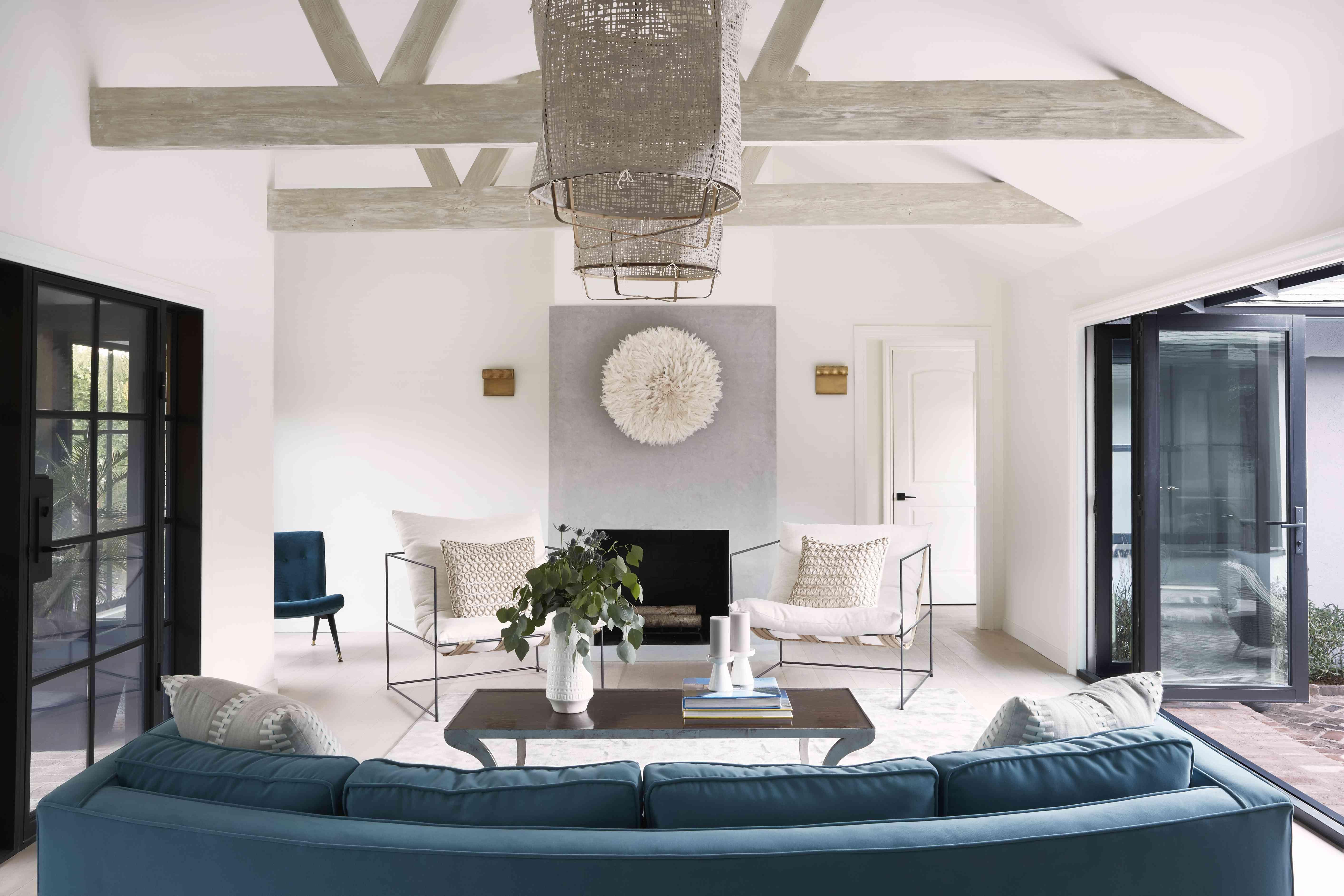 Bright handout room with blue velvet sofa.