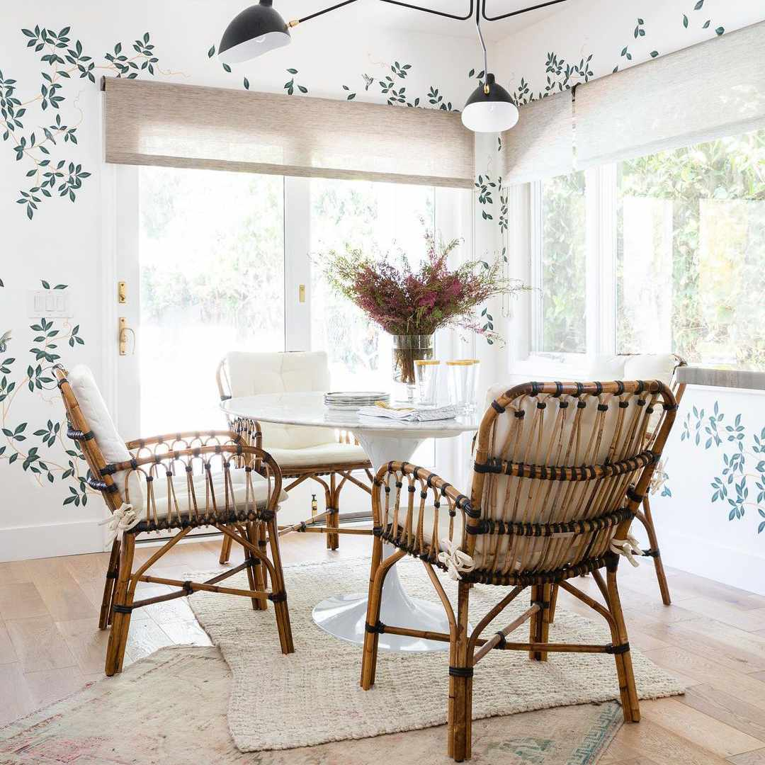 Dining room with leaf wallpaper