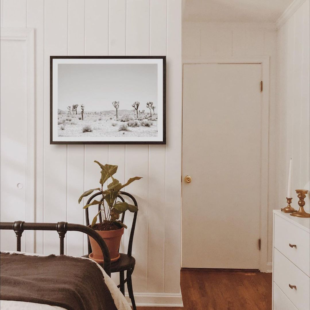 Bedroom with print hanging