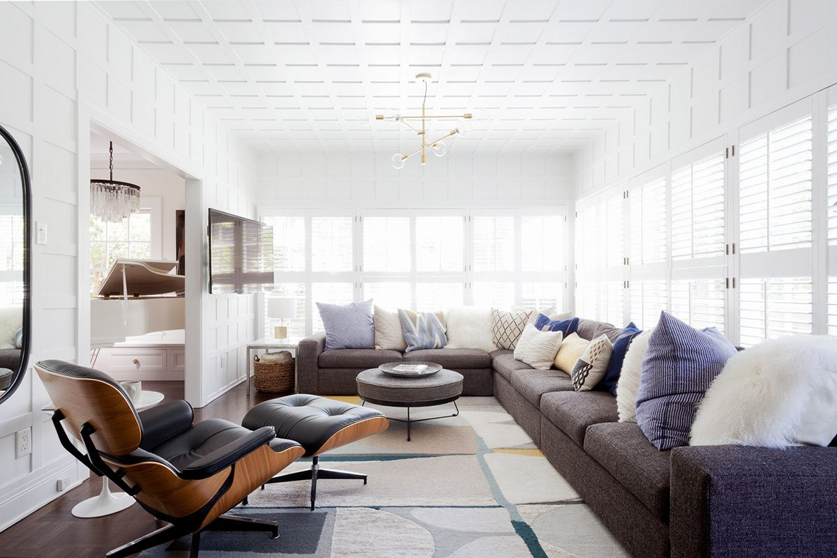Living room with textural wood panelling