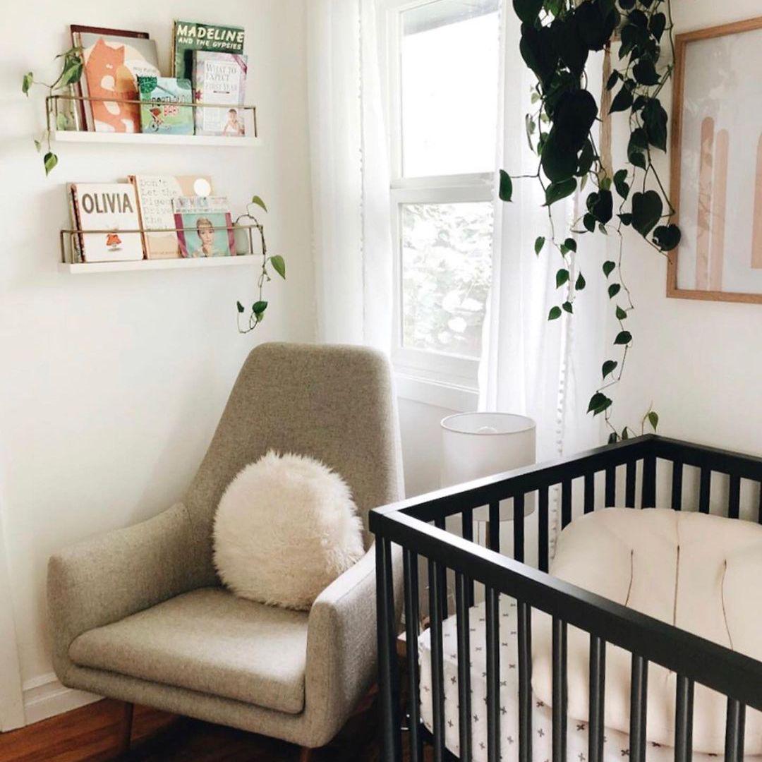 Nursery with wall book shelves