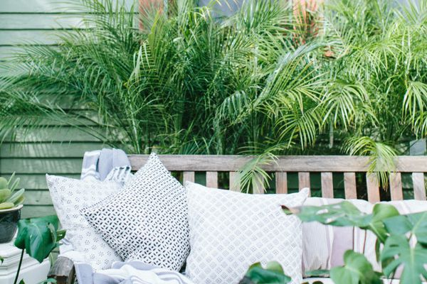 Outdoor bench with lots of greenery