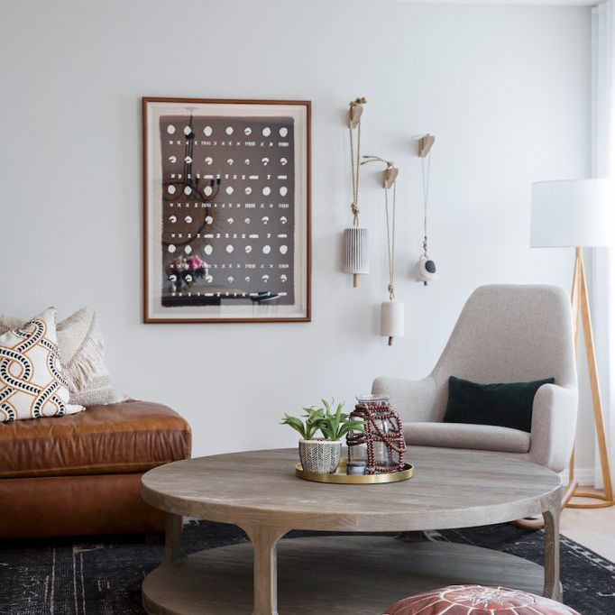 Modern boho family room with leather pouf