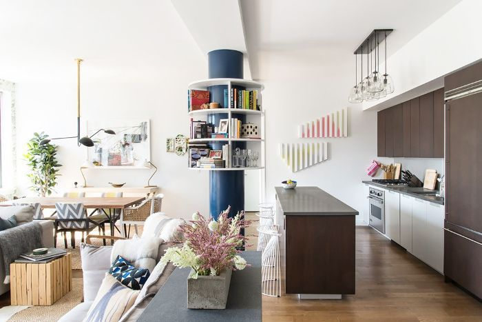 Living space defined by console table backing a sofa