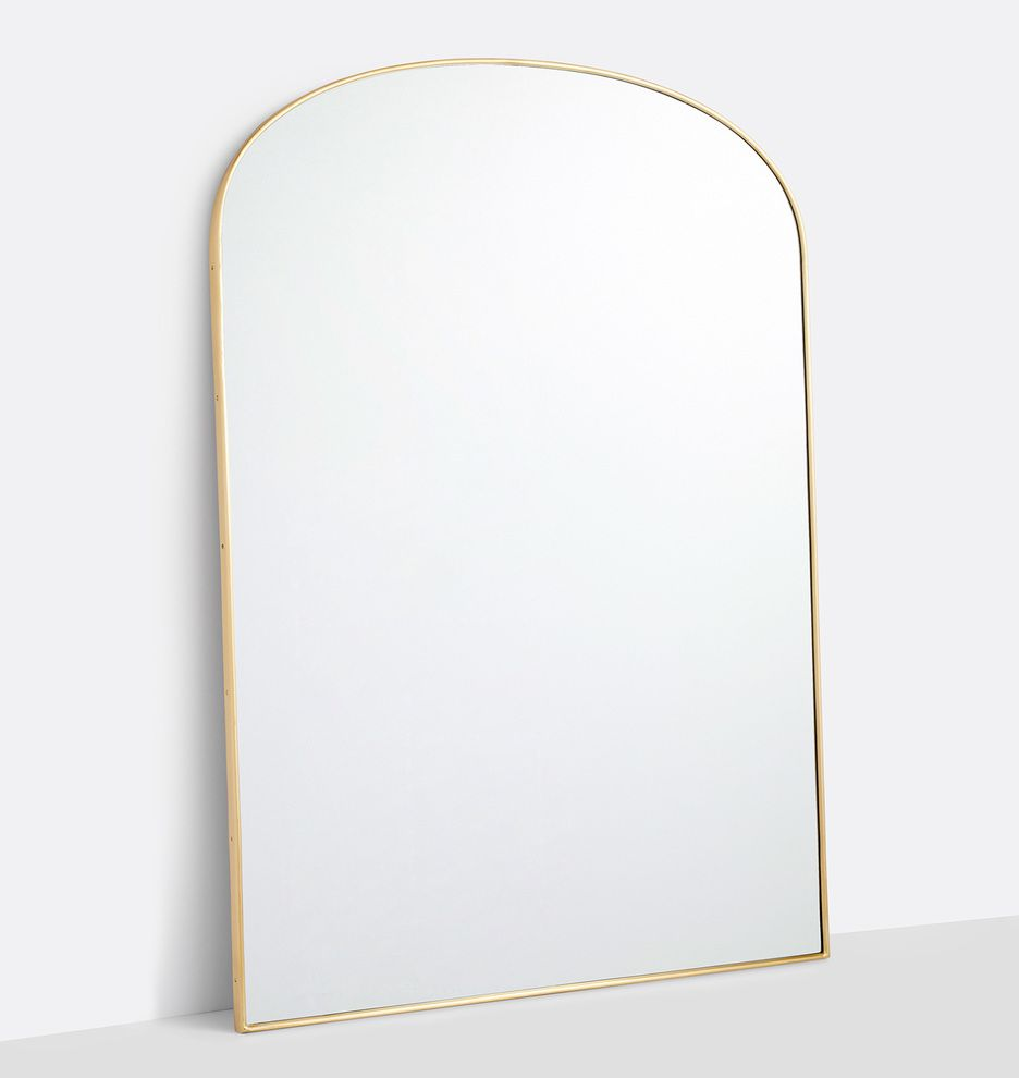 Arched metal framed floor mirror