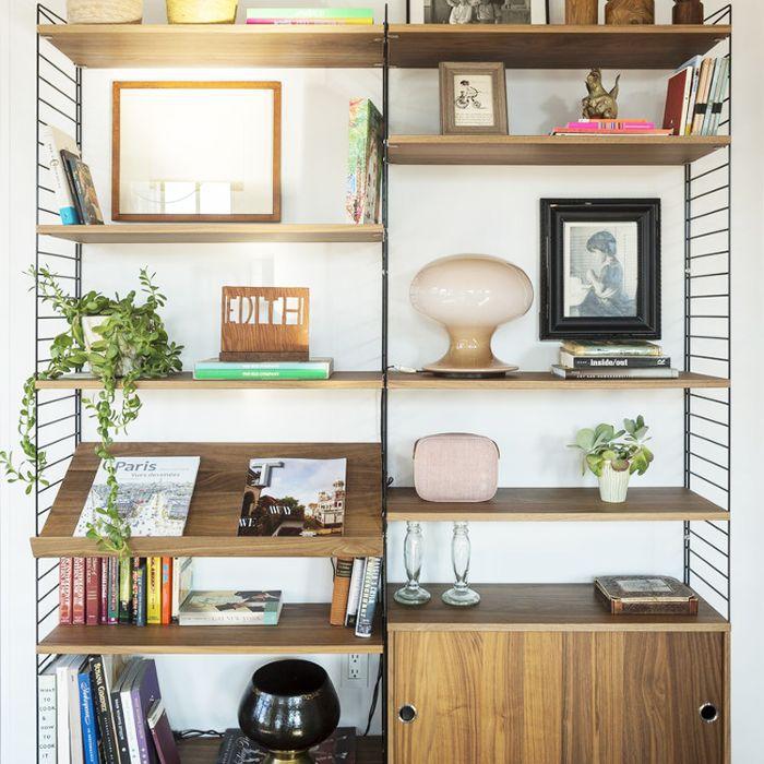 Lighting Ideas: A lamp blends into a modern bookcase