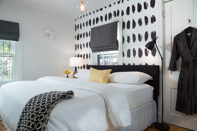 bedroom with black and white accent wall