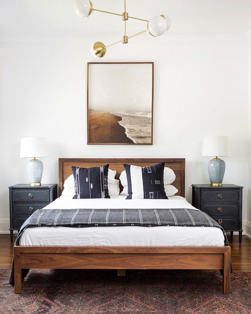 Bed with light fixture above it