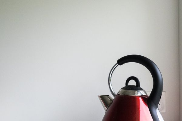 Red Electric Kettle On White Kitchen Benchtop