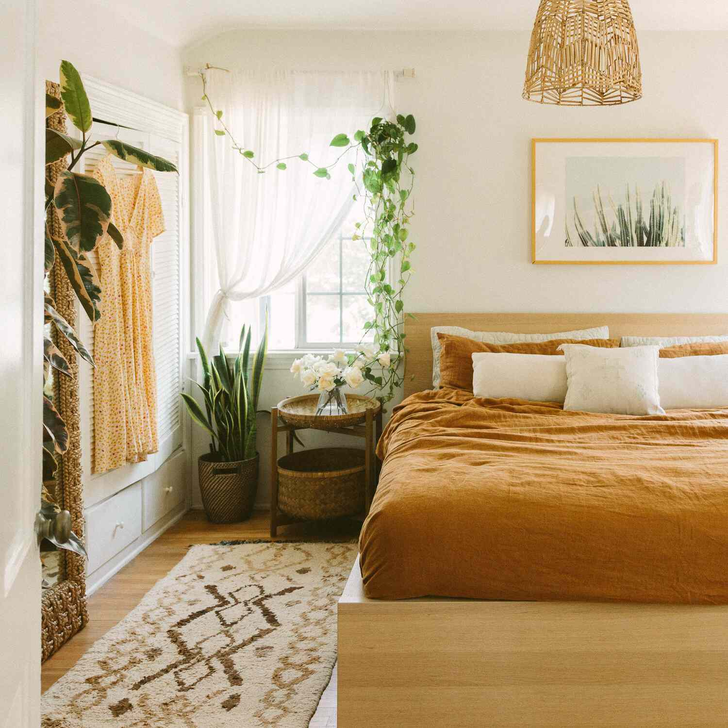 Boho rental bedroom with swapped out overhead light fixture