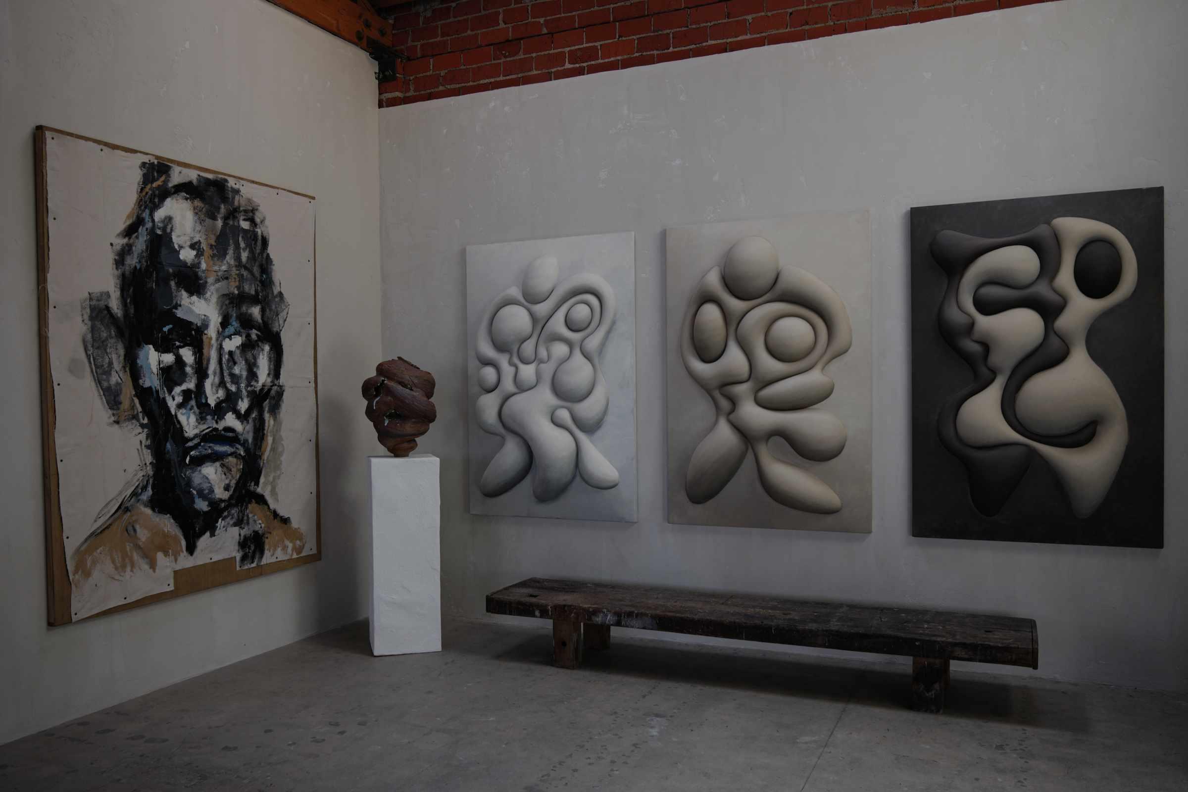 Plaster wall art in exhibit.