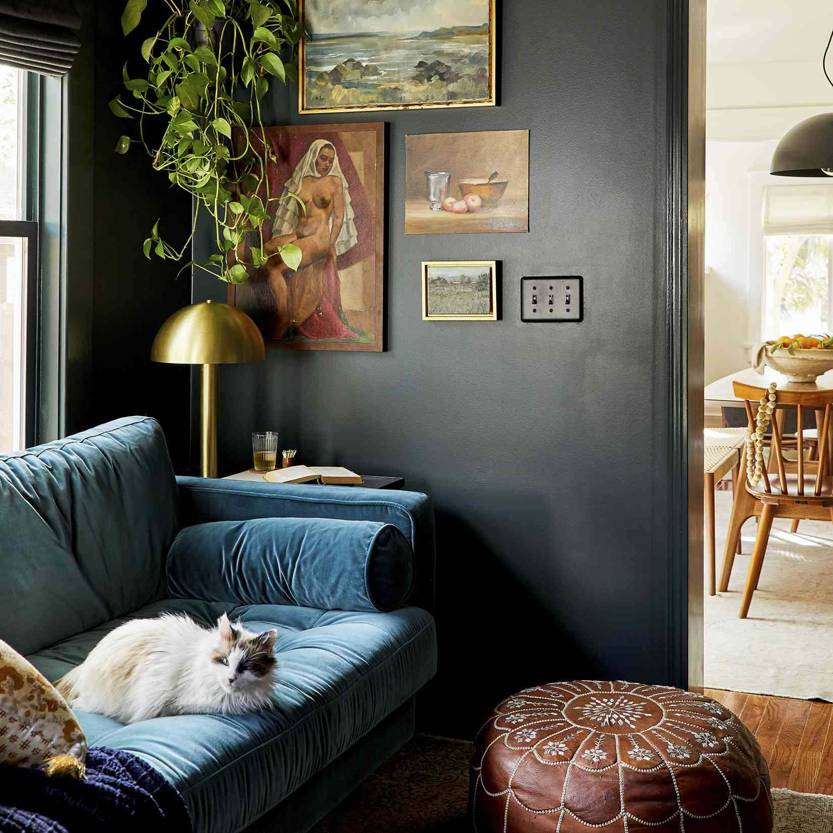 best living room ideas - dark color walls with vintage paintings