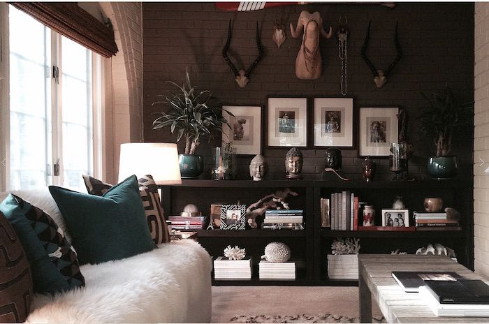 maximalist living room with eclectic gallery wall
