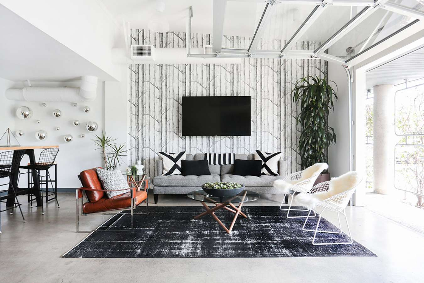 Room with a dark gray rug