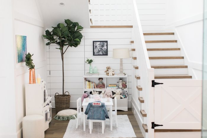 Daughter Molly's playroom is located at the bottom of the stairs