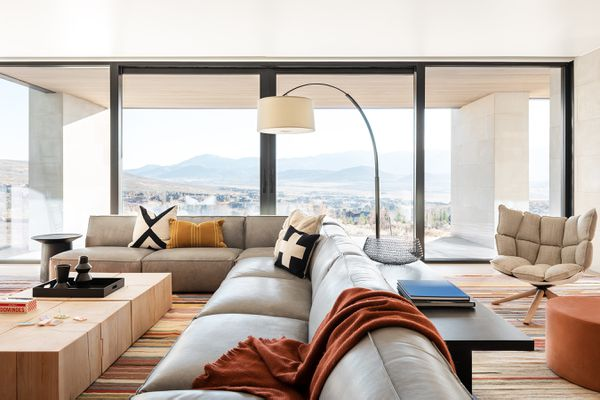 Activity room with large leather sofa and modern lamp.