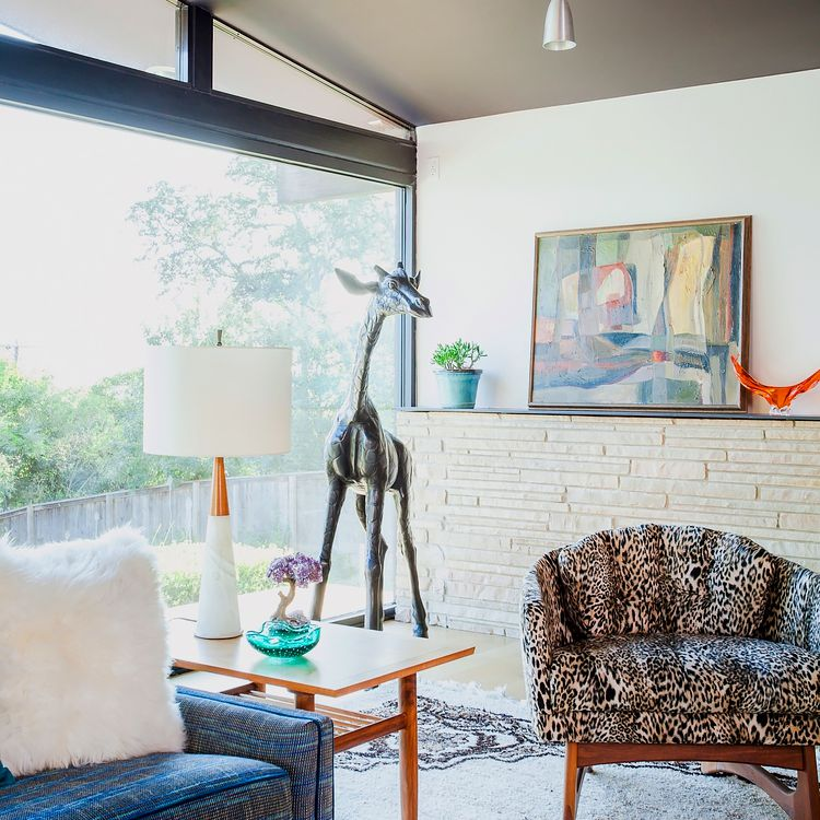 A midcentury modern living area with furniture upholstered in abstract and animal print patterns.
