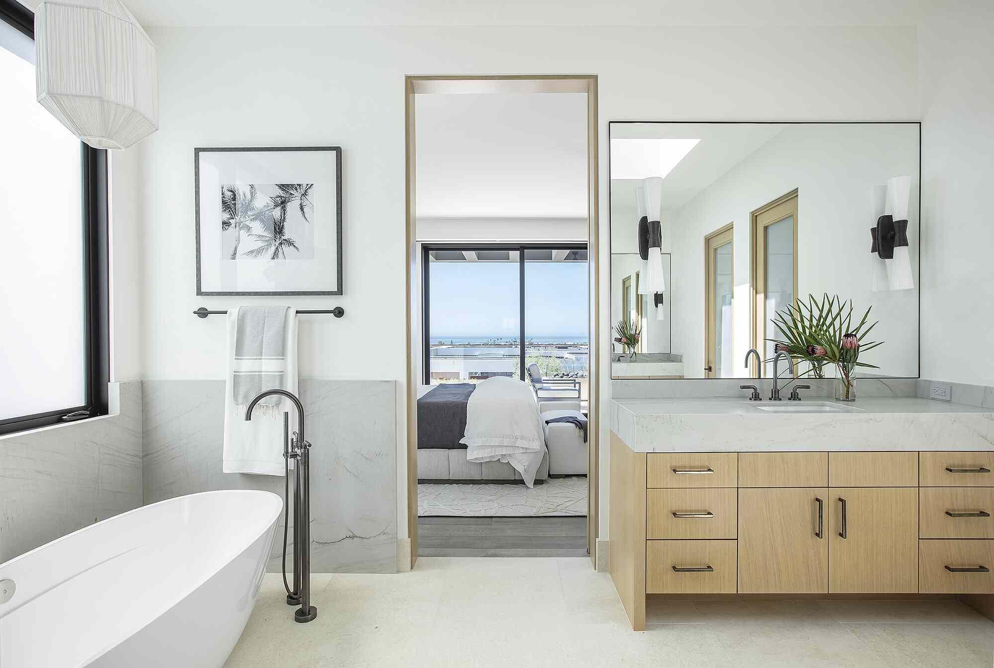 Master bathroom with light wood vanity, marble sink