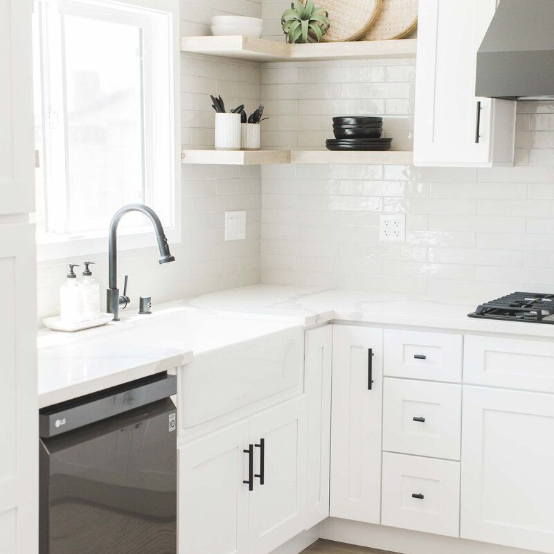 Bright white kitchen with open shelving.