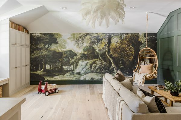Playroom with large nature mural.