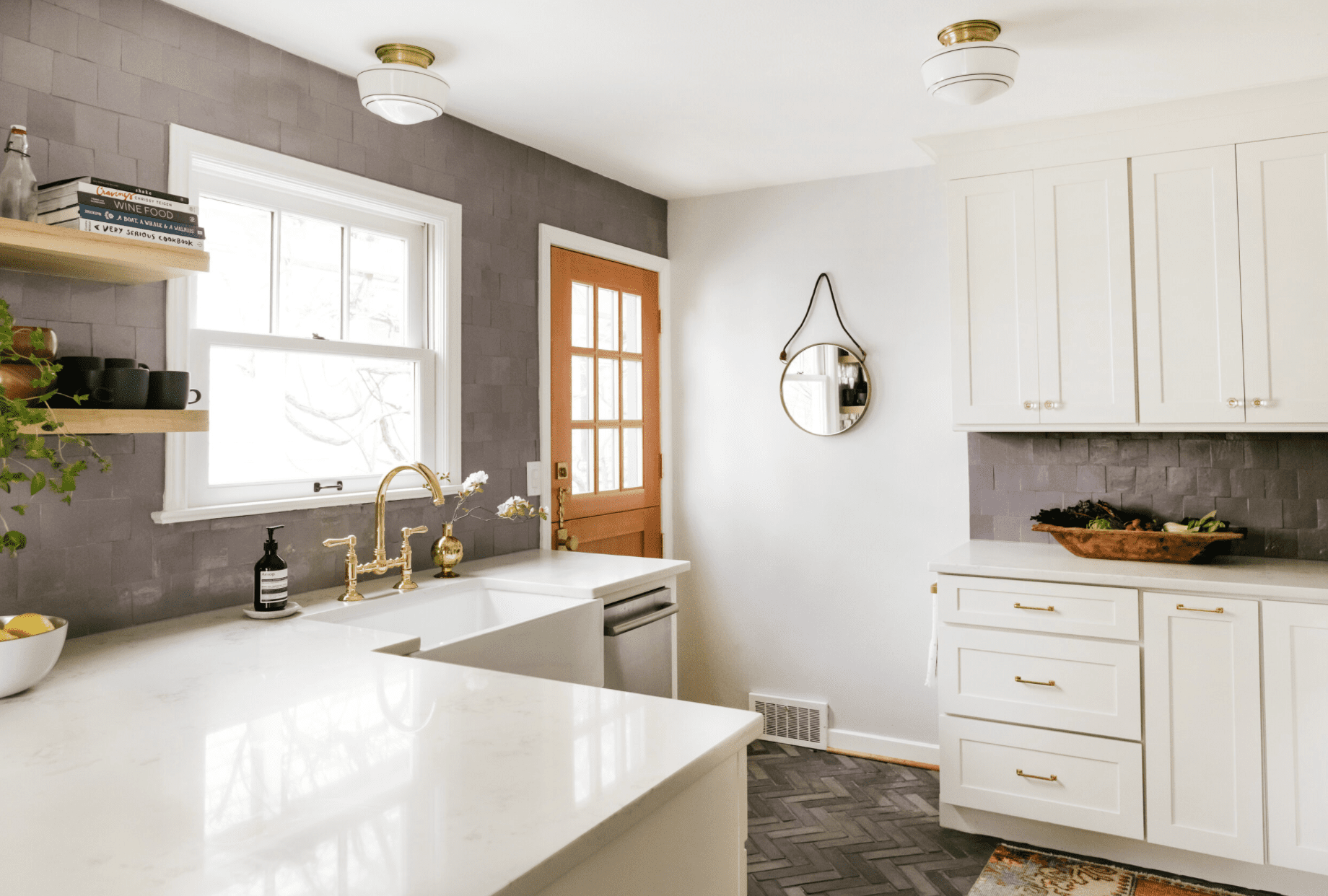 A kitchen lined with mauve tiles