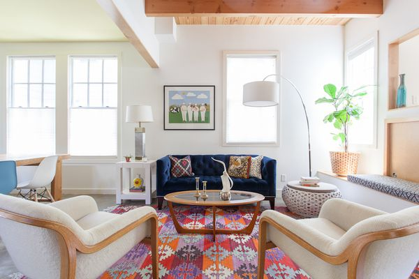 living room with blue loveseat